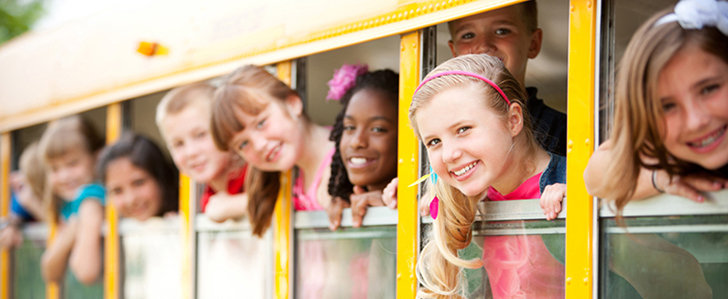 School Bus: Cute Kids Looking Out Window